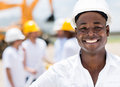 Happy male engineer at a construction site smiling Stock Images
