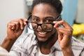 Happy male fashion designer holding eye glasses