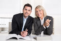 Happy male and female business team sitting in the office succe smiling successful collaboration or partnership Royalty Free Stock Image