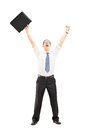Happy male holding a suitcase and gesturing happiness with raise full length portrait of raised hands isolated on white background Royalty Free Stock Photos