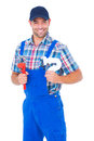 Happy male plumber holding monkey wrench and sink pipe