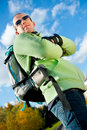 Happy man with backpack in the park. Stock Photography