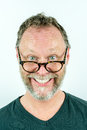 Happy man with beard and glasses laughing, funny portrait. Royalty Free Stock Photo