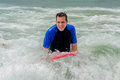Happy Man on Boogie Board in Surf Royalty Free Stock Photo