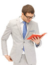 Happy man with book bright picture of Royalty Free Stock Photos