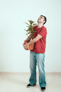Happy man with Cannabis plant Royalty Free Stock Photo