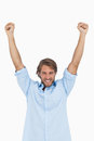 Happy man celebrating success with arms up on white background Stock Photography