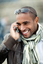 Happy man with cellphone Royalty Free Stock Image