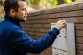 Happy man checking mail box Royalty Free Stock Photo