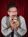 Happy man with cupcake retro style holding a Stock Photos