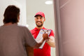 Happy man delivering parcel boxes to customer home Royalty Free Stock Photo