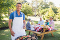 Happy man doing barbecue for his family Royalty Free Stock Photo