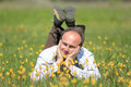 Happy man on flower meadow in sunny day Stock Photo