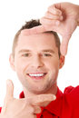 Happy man framing his face Royalty Free Stock Photo