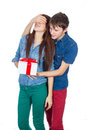 Happy man giving a gift to his girlfriend happy young beautiful couple isolated on a white background valentine holiday Stock Images