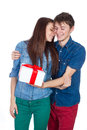 Happy Man giving a gift to his Girlfriend. Happy Young beautiful Couple isolated on a White background. Royalty Free Stock Photo