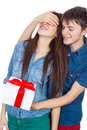 Happy man giving a gift to his girlfriend happy young beautiful couple isolated on a white background valentine holiday Royalty Free Stock Photography