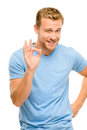 Happy man giving okay sign portrait on white background smiling Stock Photography