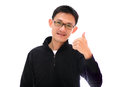 Happy man giving thumbs up sign full length portrait on white background Stock Image