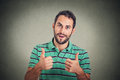 Happy man giving thumbs up sign. Positive human face expression body language Royalty Free Stock Photo