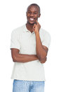 Happy man with hand on chin a white background Stock Photo