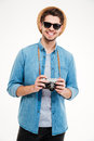 Happy man in hat and sunglasses with old photo camera Royalty Free Stock Photo
