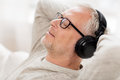 Happy man in headphones listening to music at home Royalty Free Stock Photo