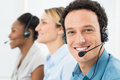 Happy man with headsets customer working other colleague in call center Royalty Free Stock Photos