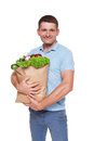 Happy man hold bag with healthy food, grocery buyer isolated Royalty Free Stock Photo