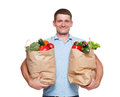 Happy man hold bags with healthy food, grocery buyer isolated Royalty Free Stock Photo
