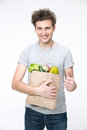 Happy man holding a bag of groceries Royalty Free Stock Photo
