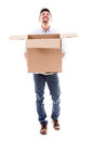 Happy man holding a box catching something isolated over white Stock Image