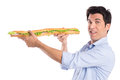 Happy Man Holding Long Baguette Sandwich Royalty Free Stock Photo