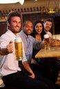 Happy man holding mug of beer in pub Royalty Free Stock Photos