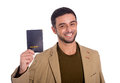Happy man holding passport isolated on white background horizontal portrait of a smiling a in casual clothes a Royalty Free Stock Image