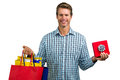 Happy man holding shopping bags and gift box Royalty Free Stock Photo