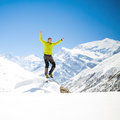 Happy man jumping in mountains Royalty Free Stock Photo