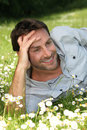 Happy man laid field Royalty Free Stock Image