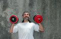 Happy man lifting dumbbell Stock Photography