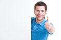 Happy man look out from blank banner young with thumb up isolated on white Royalty Free Stock Photo