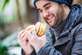 Happy man looking at a burger and sandwich - close up Royalty Free Stock Photo