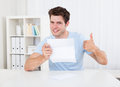 Happy Man Looking At Paper Royalty Free Stock Photo