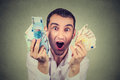 Happy man with money euro banknotes ecstatic celebrates success Royalty Free Stock Photo