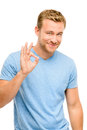 Happy man okay sign portrait on white background giving Royalty Free Stock Photos