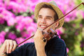 Happy man outside playing violin Royalty Free Stock Photo
