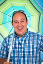 Happy man with parasol Royalty Free Stock Image