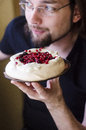 Happy man with pavlova cake Royalty Free Stock Photography