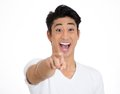 Happy man pointing closeup portrait of young student laughing with finger at someone something isolated on white background Stock Photos