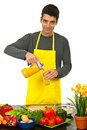 Happy man pouring orange juice Royalty Free Stock Photos
