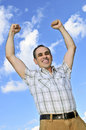 Happy man raising hands in victory Royalty Free Stock Photo